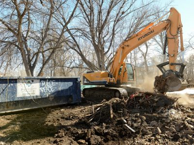 Best1 The remains of the home at 405 Prospect in Lyons is loaded into a dumpster Wednesday afternoon. Twenty seven homes in the Lyons Confluence neighborhood are being demolished this week. Lewis Geyer/Staff Photographer  Feb. 10, 2016 To view a slideshow visit www.dailycamera.com